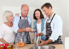Cooking in family Stock Images