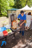 Cooking fast food shawarma outdoors in the park on the Tatar holiday Sabantuy royalty free stock photo