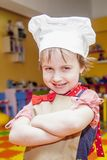Cooking fever. Humorous portrait of cute child girl chef. Cooking fever. Humorous portrait of child girl chef Stock Images