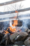 Cooking in field conditions, boiling pot at the campfire on picnic Royalty Free Stock Image