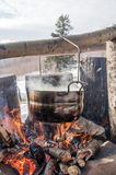 Cooking in field conditions, boiling pot at the campfire on picnic Royalty Free Stock Images