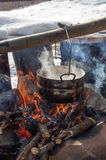 Cooking in field conditions, boiling pot at the campfire on picnic Stock Photos