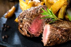 Cooking a fillet steak food photography recipe idea. stock photography