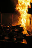 Cooking with fire. Night scene at an outdoor restaurant in Sukotai, Thailand Royalty Free Stock Photos