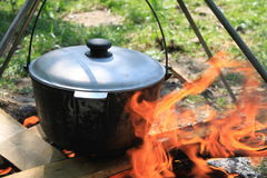 Cooking on a fire. In the summer Stock Image