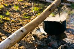 Cooking on the fire. camping in the wilderness. Healthy food made in traditional way royalty free stock photos