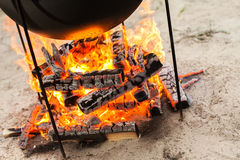 Cooking on a fire. Food in a cauldron on a fire. Food outdoors. Cooking outdoors. Cooking in nature on the cauldron Royalty Free Stock Image