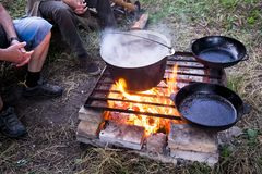 Cooking on a fire in the forest Royalty Free Stock Photography