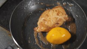 Cooking with fire in frying pan. chicken breast. Professional chef in a commercial kitchen cooking. Man frying food in. Pan on hob in kitchen. slow motion stock video