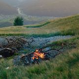 Cooking fire in mountains Royalty Free Stock Image