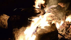 Cooking on a fire stock video footage