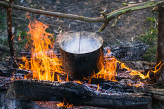 Cooking on the fire Royalty Free Stock Photos