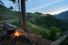 Cooking fire under house on stilts at dawn in terrace rice field in Mu Cang Chai, Vietnam.  Stock Images