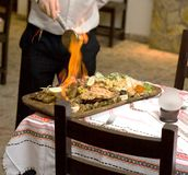 Cooking fire waiter Royalty Free Stock Photography