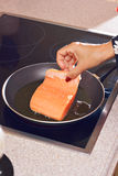 Cooking fish Stock Image