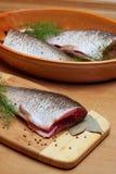 Cooking fish Stock Photos