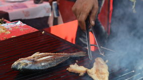 Cooking Fish in Bazaar, Istanbul. Burger with fried fish in Istanbul stock footage