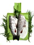 Cooking fish, carcasses of raw fish. And flour stock photo