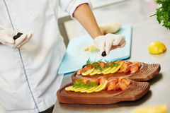 Cooking. fish food preparation Stock Images