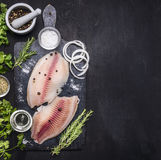 Cooking fish with herbs, butter and lemon, and pepper in mortar border place for text. Cooking fish with herbs, butter and lemon, and pepper in a mortar border royalty free stock photography