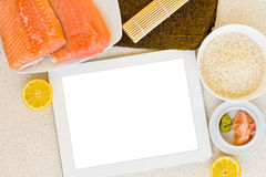 Cooking fish with tablet Stock Image