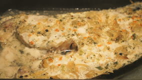 Cooking fish trout in oven stock video