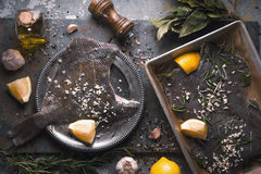 Cooking flounder with seasoning on the stone background top view Royalty Free Stock Images