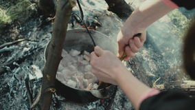 Cooking food on a campfire in forest.Camp life.Traveling. stock video