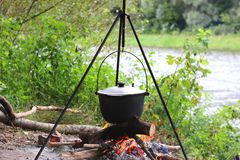 Cooking food on campfire on picnic. Cooking food on campfire in spring on picnic Royalty Free Stock Image