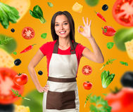 Cooking and food concept - smiling female chef Royalty Free Stock Images