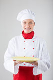 Cooking and food concept - smiling female chef, cook or baker wi Royalty Free Stock Photo