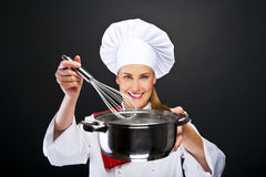 Cooking and food concept - smiling female chef Stock Image