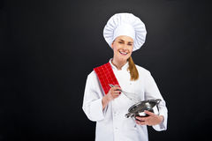 Cooking and food concept - smiling female chef wit Royalty Free Stock Photography