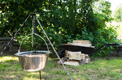 Cooking food on fire. Cooking outdoors in cast-iron cauldron. Royalty Free Stock Photos