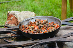 Cooking food on fire Royalty Free Stock Photography