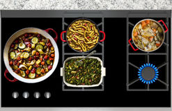 Cooking Food on a Gas Stove top panoramic view Stock Images