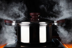 Cooking food with hot stream power of stanless steel pot on elec Stock Images