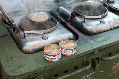 Cooking food on a military field kitchen in field conditions stock photos