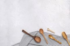 Cooking food minimal concept - wooden spoons on Crumpled napkin. Cooking food minimal concept - wooden spoons on Crumpled Striped Napkin. Top view, Flat lay stock photos