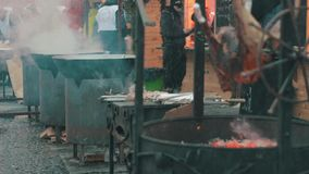 Cooking food on the open air. Christmas Market to cook delicious food, general view stock video