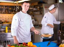 The Chef prepares food stock images