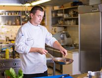 The Chef prepares food stock photos