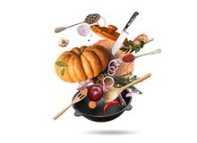 Cooking food. Yellow pan with big pumpkin and other vegetables stock photo