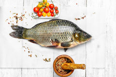 Cooking fresh carp. Process of cooking processing of fish caught carp to bake Royalty Free Stock Photography