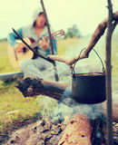 Cooking fresh food in cauldron at camp on open fire Royalty Free Stock Photo