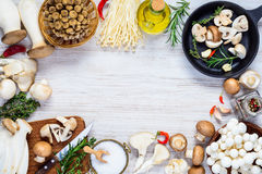 Cooking Fresh Fungi Mushrooms on Frame royalty free stock images