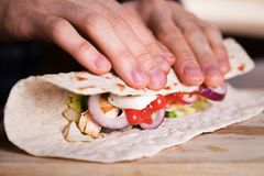 Cooking fresh homemade chicken wrap tortilla. On a wooden board Royalty Free Stock Photos