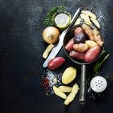 Cooking fresh potatoes Stock Photo
