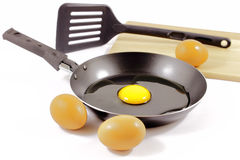 Cooking a fried egg Stock Photos
