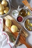 Cooking of fried potatoes, ware and ingredients. Cooking of fried potatoes,  kitchen-ware and ingredients. Top view Stock Image